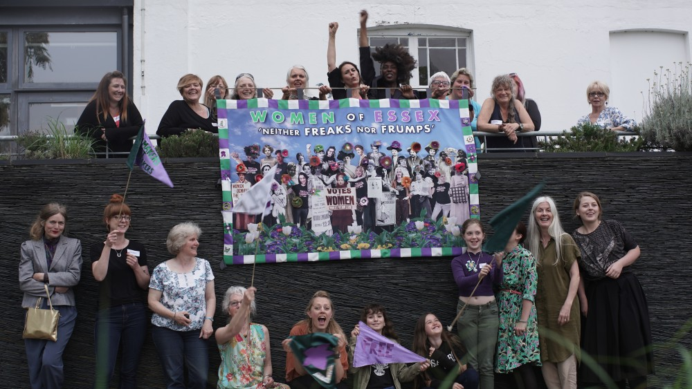 Artist Heidi Wigmore with some of the many women who helped to create the Women of Essex Banner
