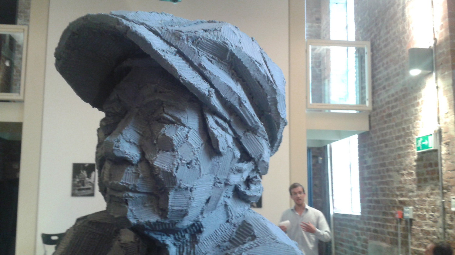 A sculpture of a mans head wearing a cap, by Adrian Jeans